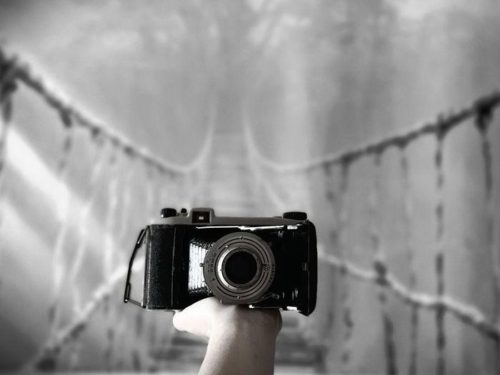 Close-up of hand holding camera