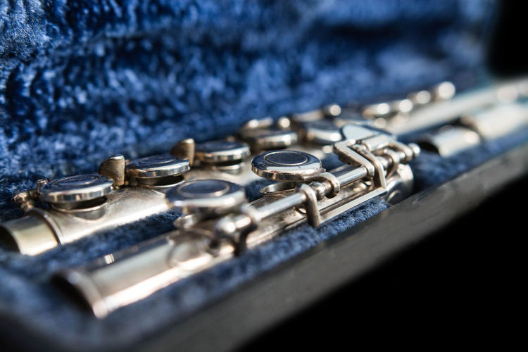 A transverse flute in its case. Box Music Arts Culture And Entertainment Blue Car Close-up Disassembled Flute Metal Music Musical Equipment Musical Instrument No People Selective Focus Silver  Transverse Wind Instrument