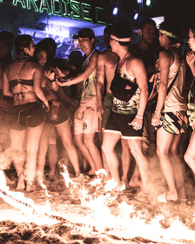 In the Line of Fire Group Of People Large Group Of People Crowd Night Real People Women Men Leisure Activity Emotion Togetherness Enjoyment Event Happiness Nightlife Fire Rope Burning Party Party - Social Event Glowing Illuminated Illumination Beach Sky