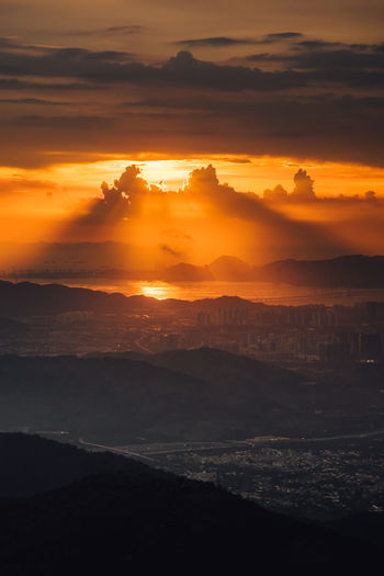 Sunset Beauty In Nature Sky Scenics - Nature Cloud - Sky Orange Color Tranquil Scene Tranquility Idyllic No People Nature Environment Sun Water Landscape Dramatic Sky Outdoors Non-urban Scene Mountain