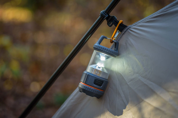Close-up of camping light on tent
