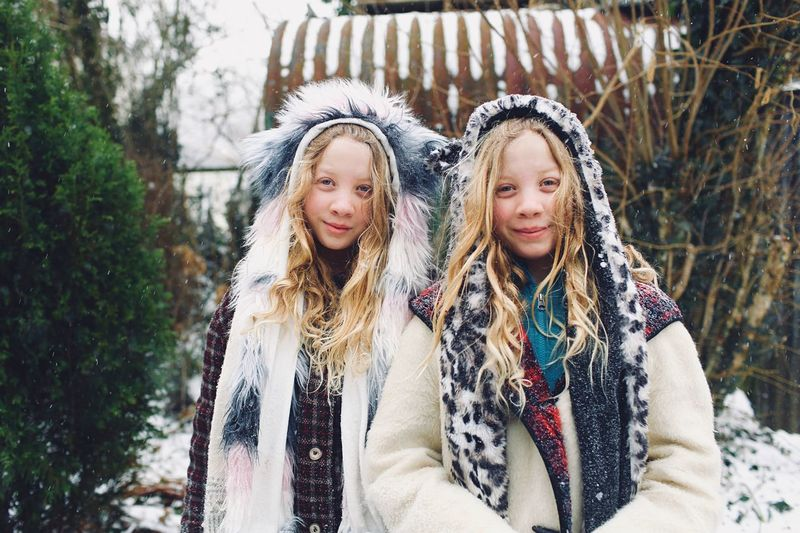 Twins snow adventure Portrait People Adventure Girls Child Children Only Two People Outdoors Cold Temperature Sibling Happiness Smiling Winter Portrait Front View Fun Females Warm Clothing Togetherness Hair Sister Family Childhood
