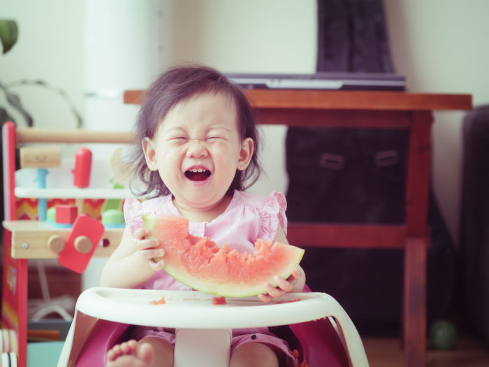 baby girl eating watermelon at home Babygirl Chair Childhood Close-up Cute Day Eating Enjoyment Food Food And Drink Freshness Front View Happiness Indoors  Lifestyles Live For The Story One Person People Real People Sitting Summer Sweet Food Watermelon