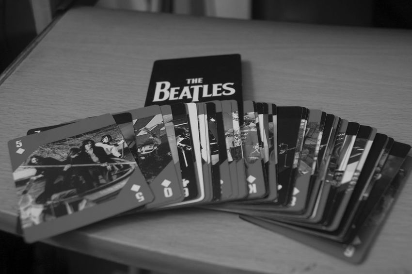 Arrangement Beatles Black & White Black And White Cards Close-up Communication Fab Four George Harrison High Angle View Indoors  John Lennon Large Group Of Objects No People Number Paul Mccartney Poker Ringo Starr Selective Focus Table Text The Beatles Variation Western Script Wood - Material