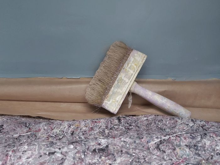 High angle view of paintbrushes on floor