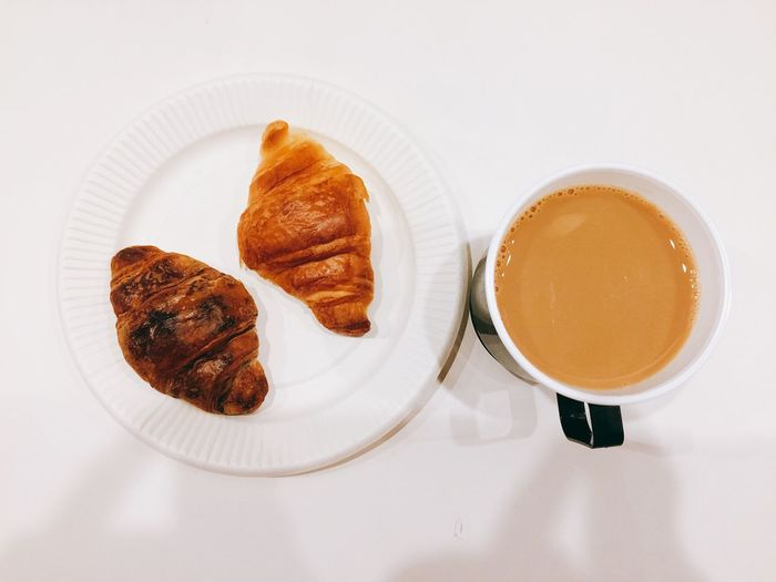 EyeEm Selects Food And Drink Food Plate Croissant Still Life High Angle View Freshness White Background Drink Table Serving Size Directly Above Ready-to-eat Sweet Food Indoors  No People Breakfast Close-up Day Coffee Cafe Latte Break The Mold Tea Time Hot Drink