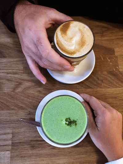 Matcha latte Matcha Matcha Lattee Latte Green Tea Latte Healthy Drinks Lattes Food And Drink Drink Human Hand Refreshment Coffee Coffee Cup Holding Coffee - Drink Frothy Drink Hot Drink Table Hand Date Coffee Date