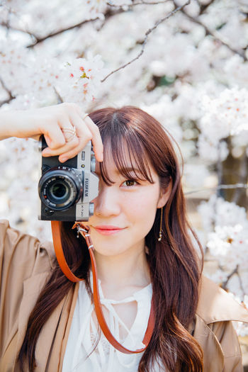 Japanese girl took photos at cherry blossom garden Beautiful Camera Cherry Blossom Japan Tokyo Beautiful Woman Beauty Beauty In Nature Camera - Photographic Equipment Flower Fuji Lifestyles Long Hair Portrait Portrait Photography Young Women EyeEmNewHere