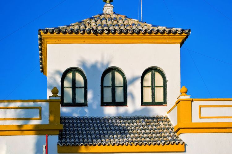 Spanish Arquitecture Spanish Style House Villa Andalucía Andalusia Tourism SPAIN Decoration Window White Wall Blue Sky Bright Colors Arhitecture Blue Architecture Building Exterior Window Yellow Built Structure Outdoors Travel Destinations Multi Colored Clear Sky No People