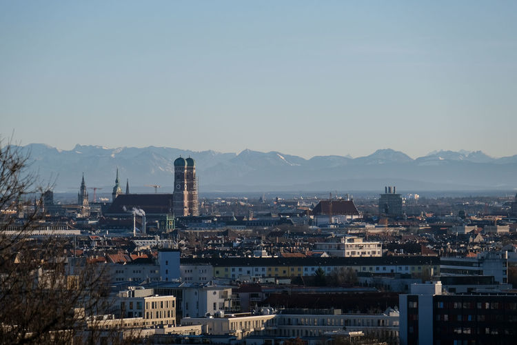 High angle view of munich skyline against bavarian alps and clear sky