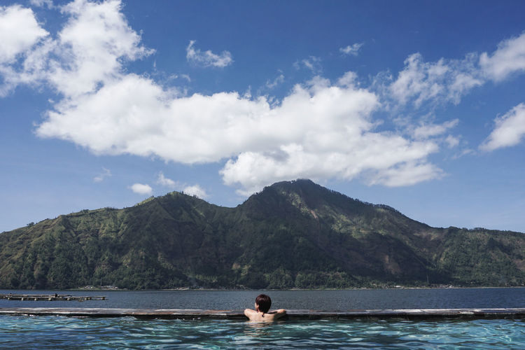 Beauty In Nature Cloud - Sky Day Lake Landscape Mountain One Man Only One Person Relax Relaxation Relaxing Scenics Sky Swim Tranquil Scene Tranquility Vacations Water