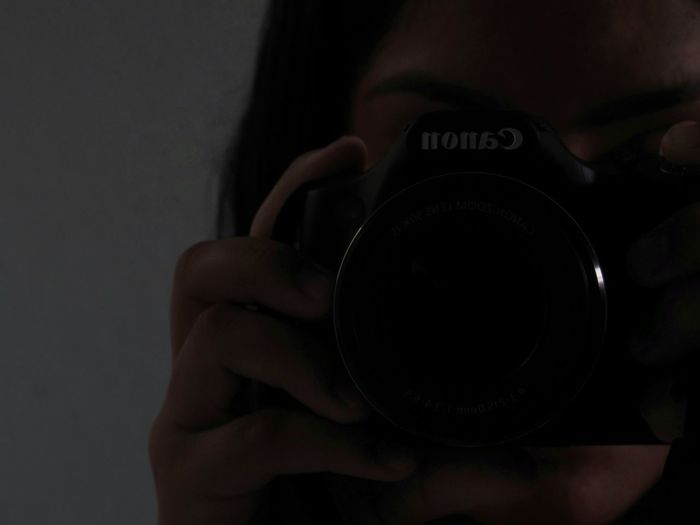 Home Video Camera Indoors  People Adult Leisure Activity Technology Photographic Equipment Photographer Digital Camera Adults Only Human Body Part Close-up One Person Holding Photographing Camera - Photographic Equipment Photography Themes