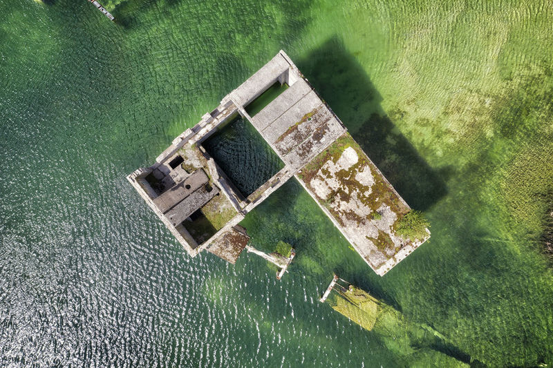 High angle view of abandoned floating on water