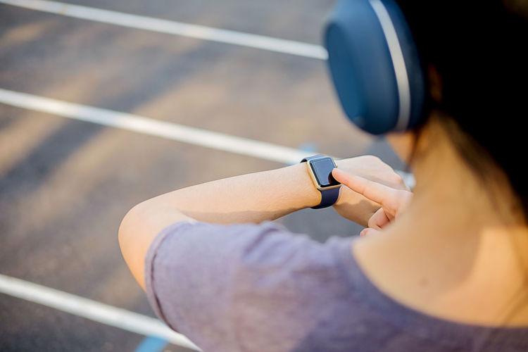 Adult Checking The Time Close-up Day Focus On Foreground Hairstyle Healthy Lifestyle High Angle View Holding Human Body Part Lifestyles One Person Outdoors Real People Selective Focus Smart Watch Sport Technology Wearable Computer Women Young Adult Young Women
