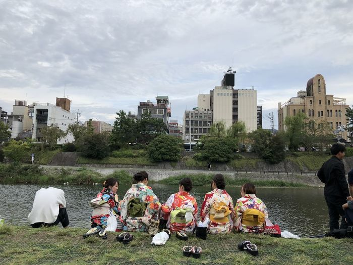 Hanging at the canal. Sitting Leisure Activity Traditional Clothing Japanese Culture Real People Outdoors