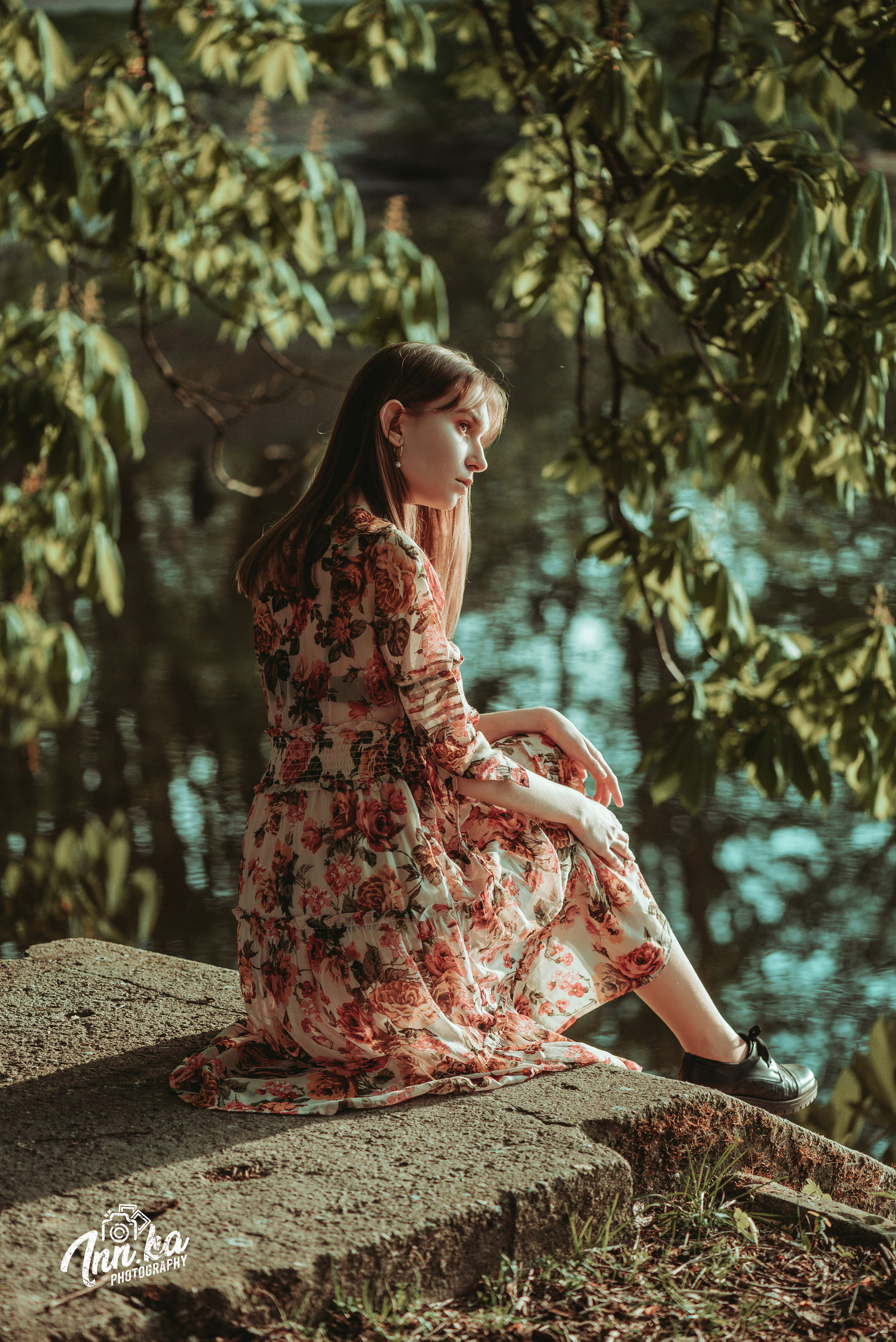 one person, tree, women, adult, autumn, dress, nature, plant, clothing, young adult, forest, fashion, spring, land, hairstyle, looking, sitting, outdoors, female, tranquility, plant part, beauty in nature, lifestyles, long hair, contemplation, elegance, leaf, gown, sunlight, portrait, photo shoot, brown hair, woodland, relaxation, full length