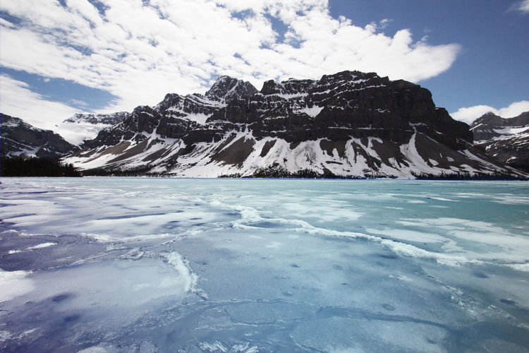 Bow Lake Sky Beauty In Nature Scenics - Nature Water Cloud - Sky Cold Temperature Winter Tranquil Scene Mountain Nature Tranquility Day Snow Frozen No People Ice Idyllic Waterfront Outdoors Snowcapped Mountain Iceberg Bow Lake Close-up Icefields Parkway