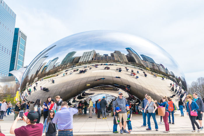 """the cloud gate, also known as """"the bean"""" at the Millenium park in Chicago Architecture Building Exterior Cloud Gate Cloud Gate Chicago Millenium Park Modern People Reflection The Bean The Bean Chicago"""