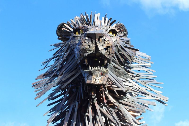 The Mighty Aslan Animal Themes Day VSCO Eyes Metal Character Book Story Northern Ireland EyeEm Selects Art Animal Tourism Photography Narnia  Aslan Statue Lion Low Angle View Blue Day Outdoors Sky No People Clear Sky Close-up Focus On The Story