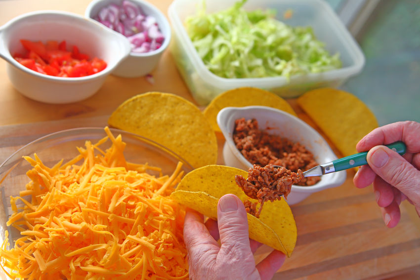 Older man making tacos Chopped Onion Chopped Tomatoes Close-up Colorful Dinner Fingers Food Preparation Freshness Grated Cheese Green Ground Beef Hands Holding Home Food Homemade Food Indoors  Man One Person Point Of View Shredded Lettuce Supper Taco Night Taco Shells Vegetables Yellow
