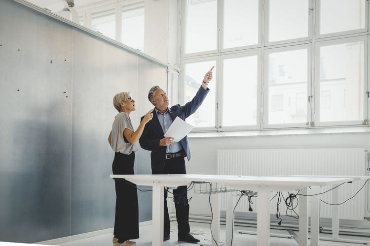 Man and woman standing on table