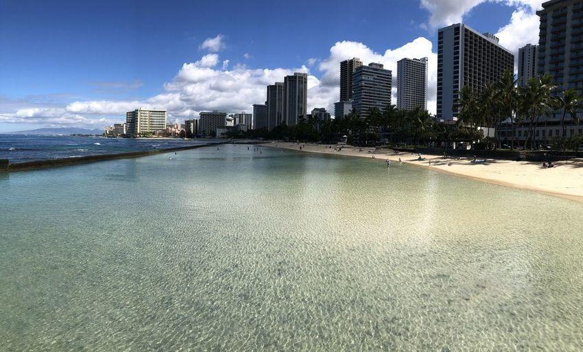 City by sea against sky