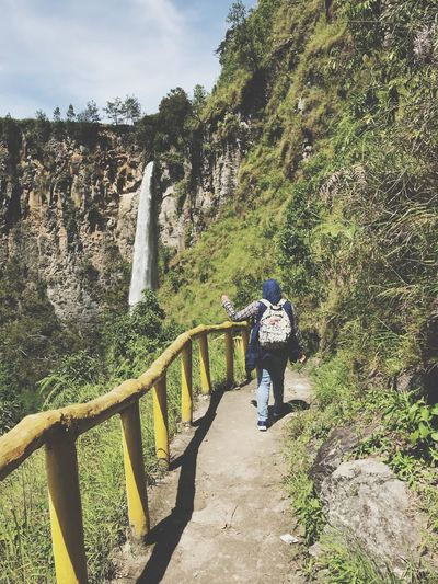 into the waterfall INDONESIA ASIA Waterfall Real People Rock - Object Beauty In Nature Lifestyles Nature Leisure Activity Full Length Backpack Hiking Scenics Adventure Travel Mountain Casual Clothing One Person Outdoors Day Rear View
