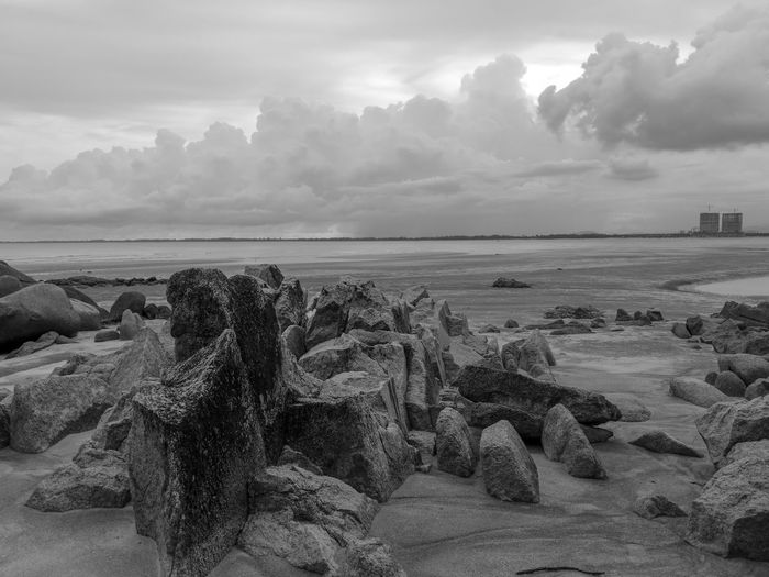 Beach Rock Rocky HuaweiP9 Huaweiphotography Leica Lens Monochrome Black And White No People Two Different Worlds Beach Beauty In Nature Kuantan Pahang Malaysia Tembeling Resort Beach Sand Dune Sea Sand Sky Landscape Horizon Over Water Cloud - Sky