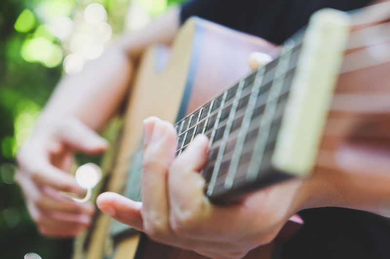 Cropped Image Of Man Playing Guitar