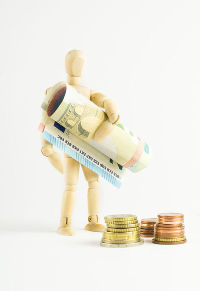 Accumulate Money Bank Notes Business Carry Coin Coins Corporate Business Currency Euro Figure Finance Investment Little Man   Make Money Making Money One Person Paper Currency Rake In Money Savings Shovel In Money Stack Studio Shot Wealth White Background Wooden Figure