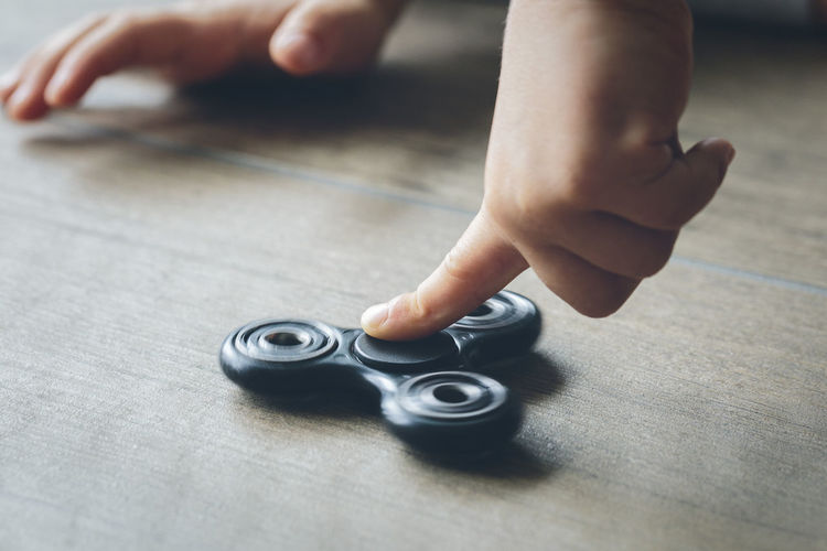 Boy playing with fidget spinner
