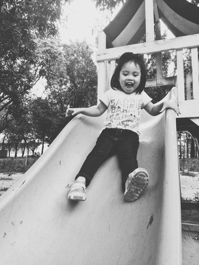 Child Childhood Elementary Age Happiness Outdoors Playground Playing Portrait Sitting