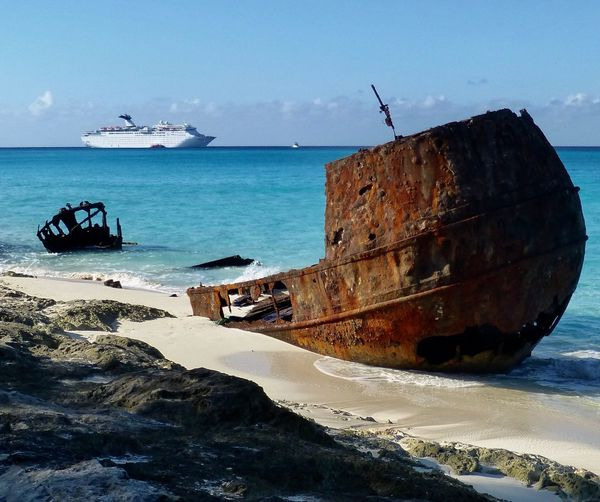 Sea Nautical Vessel Water Transportation Beach Nature Mode Of Transport Rock - Object Abandoned Sky Beauty In Nature Day Outdoors No People Scenics Tranquility Sand Horizon Over Water Sunken