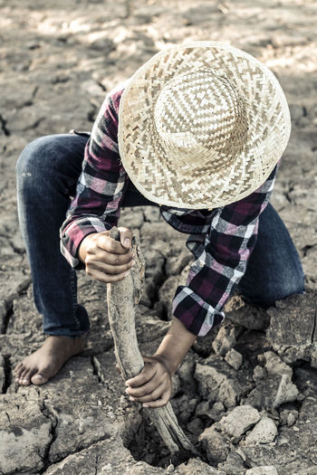 Man Digging Cracked Field