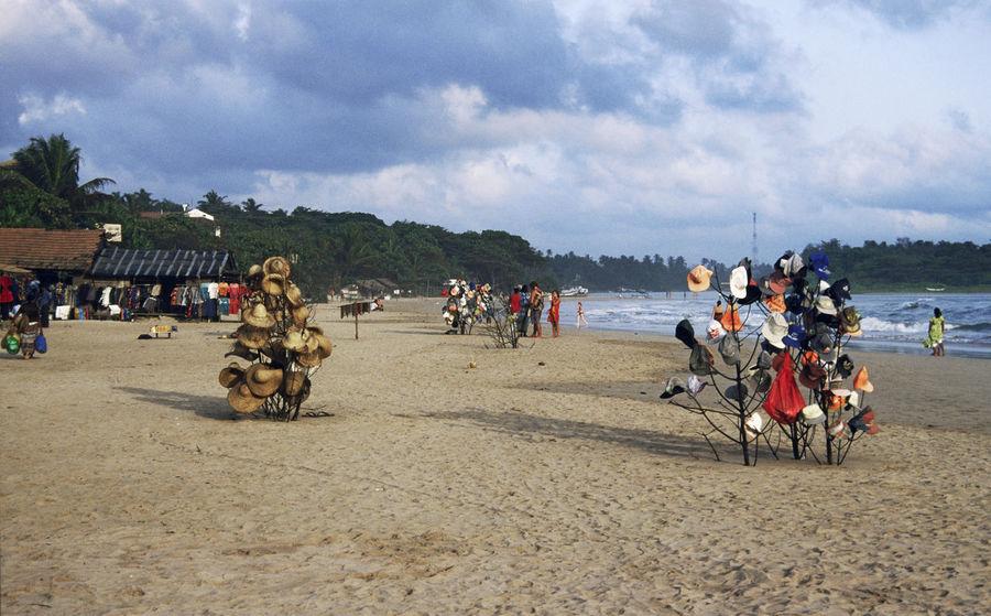 Hat stands on the beach at Sri Lanka ASIA Beach Bentota Bewuwela Day Hat Stans Landscape Shore Sri Lanka Tourism Tourist Travel Travel Destinations Vacations
