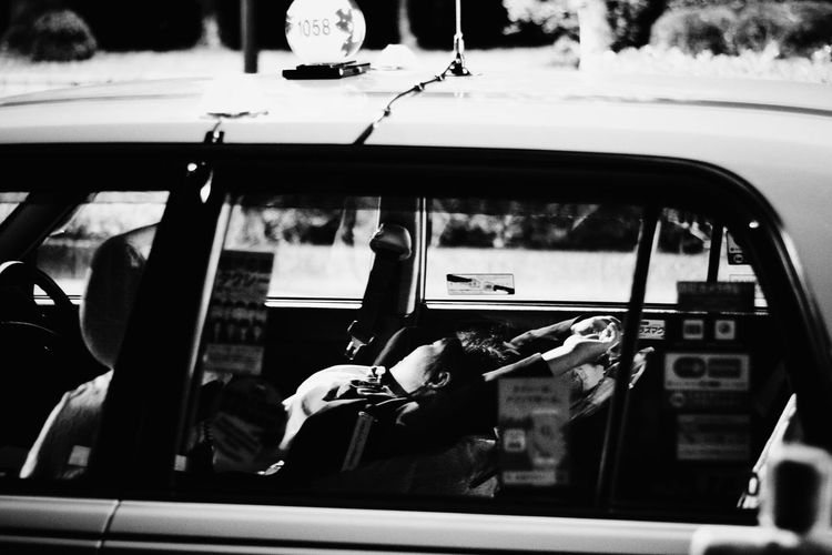 Blackandwhite Bus Day Japan Journey Land Vehicle Leisure Activity Lifestyles Mode Of Transport Part Of Public Transportation Sleep Streetphotography Taxi Transportation Vehicle Interior Windshield Shootermag The Street Photographer - 2016 EyeEm Awards Night Night, Sleep Tight Ultimate Japan