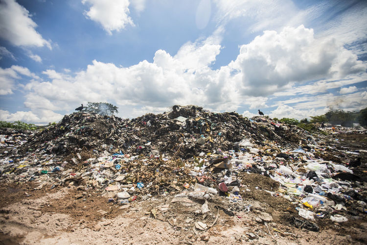 Panoramic view of garbage on land against sky