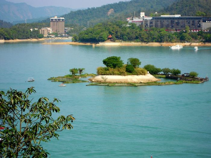 View of the small Lalu Island from Nantou district in Taiwan Water Tree Lake Lalu Island Travel Destinations Nautical Vessel Outdoors Nature No People Sailboat Harbor Architecture Day Beauty In Nature