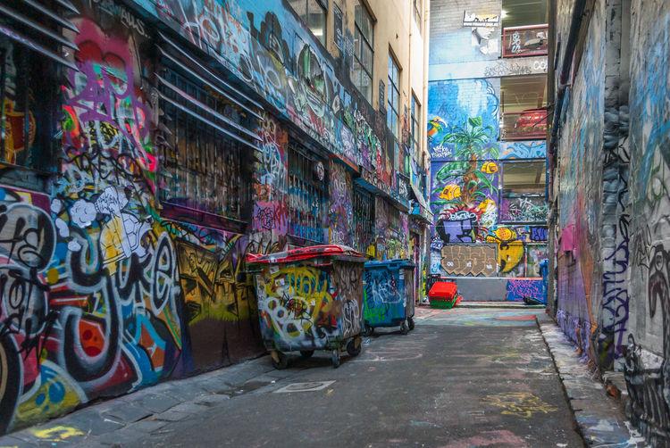 Graffiti on alley in city