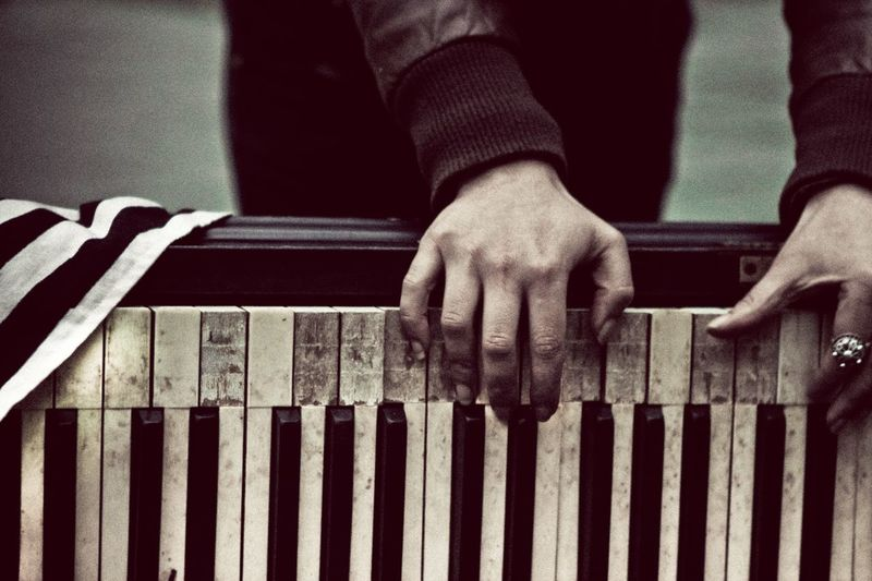 Cropped image of woman playing damaged piano