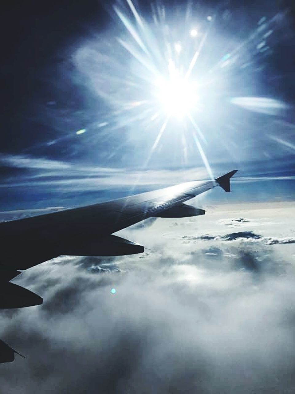 airplane, transportation, sunbeam, sky, sun, cloud - sky, flying, no people, airplane wing, nature, sunlight, journey, blue, air vehicle, outdoors, day, travel, beauty in nature, aerial view, scenics