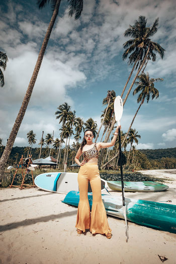 Young Adult Sky Full Length Cloud - Sky Young Women One Person Water Tree Tropical Climate Palm Tree Real People Nature Clothing Leisure Activity Front View Lifestyles Portrait Plant Fashion Beautiful Woman Outdoors