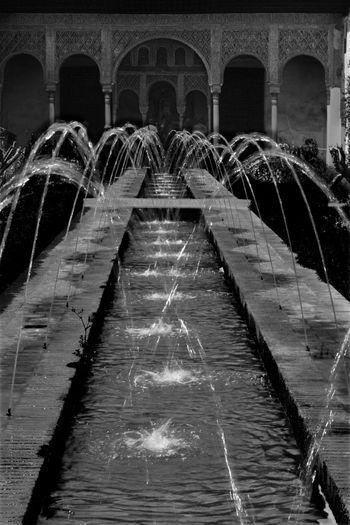 Illuminated bridge in water