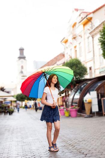 Full length of woman standing in rain