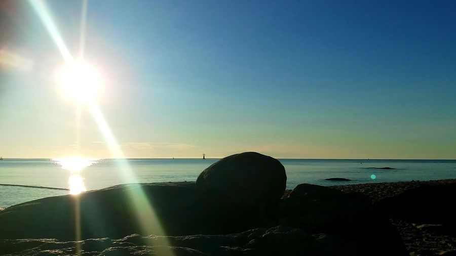 Water Sky Sea Scenics - Nature Beauty In Nature Tranquil Scene Sunlight Rock Sun Rock - Object Horizon Horizon Over Water No People Land Lens Flare Beach Outdoors Bright Sunbeam Solid
