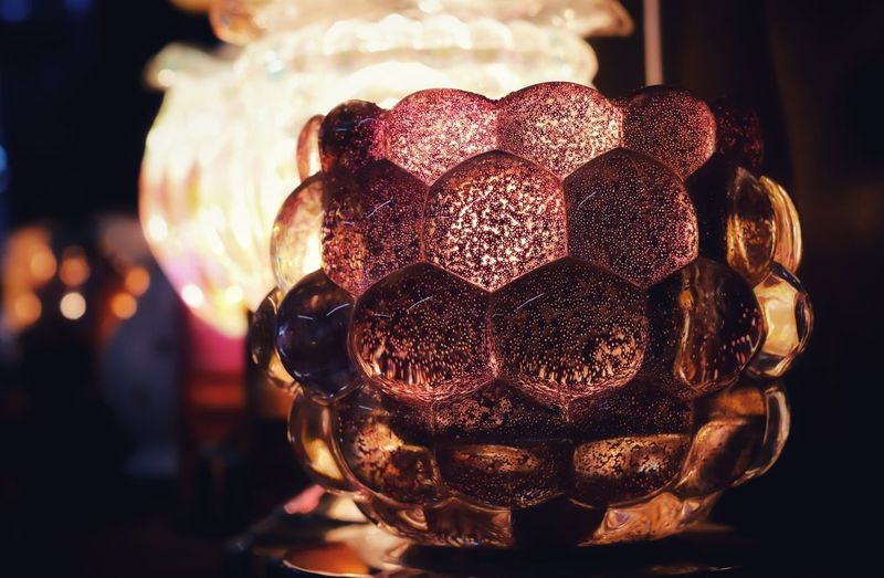 Close-up of illuminated ball on table