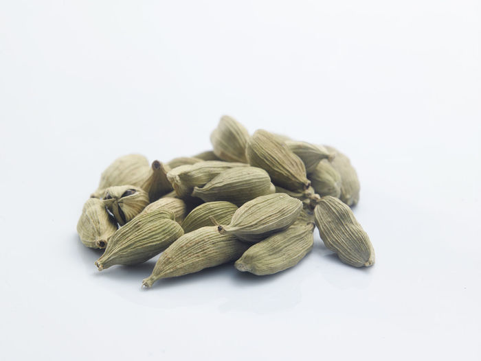 Close-up of cardamoms against white background