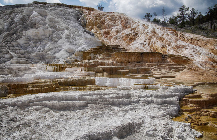 Terraces made of crystallized calcium carbonate in the Mammoth Hot Springs Historic District ,Yellowstone National Park Geothermal Fields Mammoth Hot Springs Area Tourist Attraction  Travel Photography Yellowstone National Park Beauty In Nature Crystallized Calcium Carbonate Flowing Geology Geothermal  Geothermal Activity Hot Spring Landscape Mommoth Hot Springs Mountain Nature Nature_collection No People Physical Geography Rock Formation Scenics - Nature Travel Destinations Travertine Terraces Volcanic Landscape Water