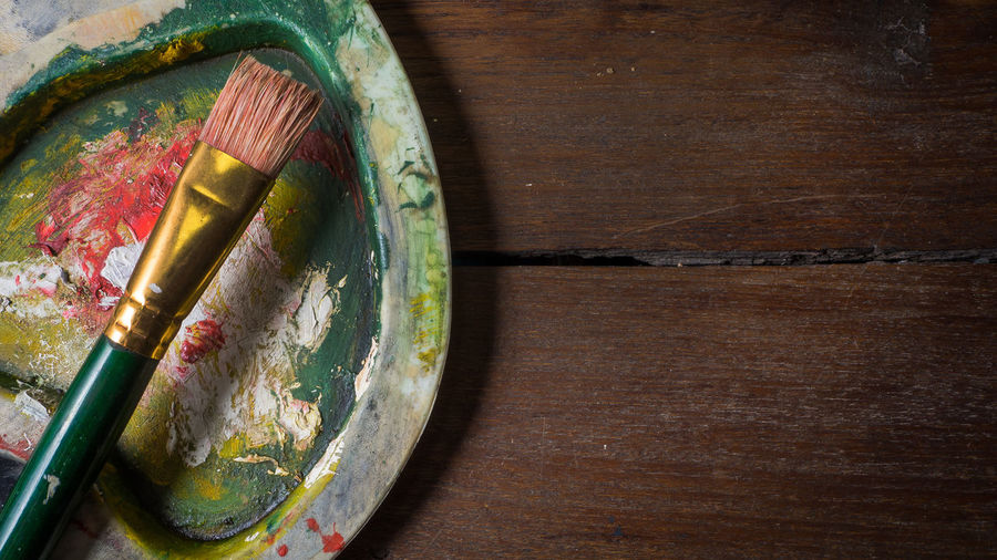 Close-up of paintbrush and palette on table