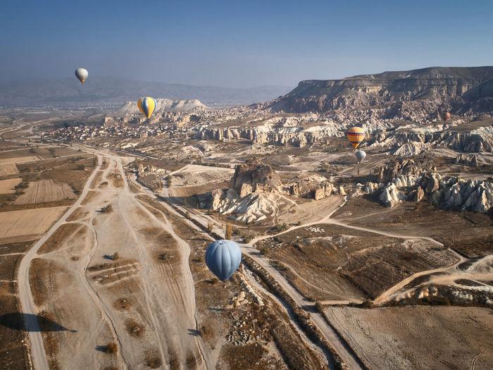 Colorful hot air balloons at goreme national park, cappadocia, turkey. aerial view